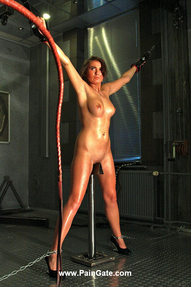 Flogging blonde in bondage